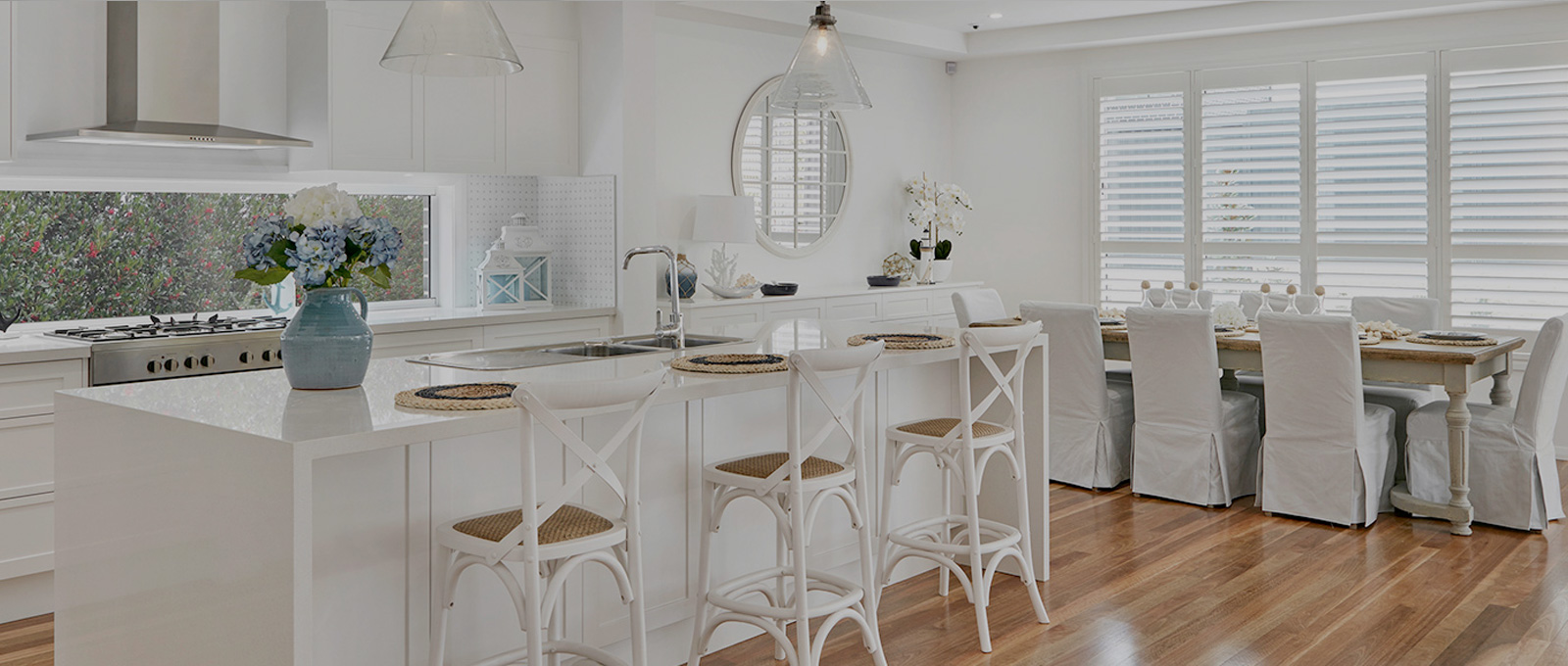 Kitchen area in the modern house with a dining table